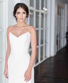 • E D D I E • This simple, modern, statement gown is a must see for any bride who is looking for a strong minimalist look for their special day. Karen Willis Holmes