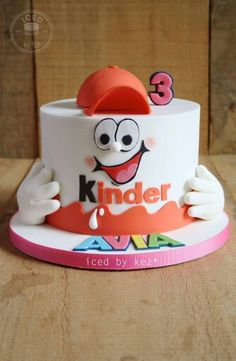 "Cake by ""Iced by Kez"" 7"" chocolate Kinder Surprise. Love this"