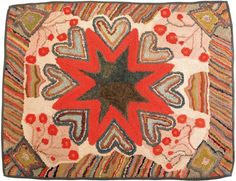 "Realized Price: $10073   American hooked rug, ca. 1900, with a central star surrounded by hearts and potted flowers, 35"" x 44"""