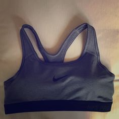 Gray Nike Pro Sports Bra Medium Support Brand new with tags Nike gray sports bra. Medium support (padded). Only ever tried on. Never worn. Couldn't find the receipt. Didn't fit. Dri-fit material is great for any workout or sport! Price is firm on this item. Nike Other