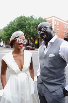 Erin and Kwame's engagement photos with dog, so cute! Location: Harlem, NYC | High Heels: Silver Jimmy Choo | Wedding Photographer New York: XOANDREA | Black engagement ideas | vintage engagement, engagement ideas, engagement photos inspo, wedding turban