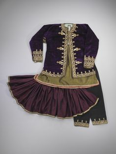 """Ensemble  Early 20th Century  Mashhad, Iran  When Qajar Shah Nasir al-Din and his wife embarked on a journey to Europe in 1873, they were inspired by the """"ballerina"""" skirts they saw in Paris. Upon returning to Iran, they brought with them a new style of dress, characterized by heavily-pleated short skirts and tight pants. (Israel Museum) Israel Museum"""