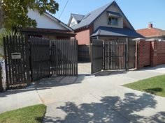 Trackless Bi-fold Automatic Gates - Steel Pickets - www.themotorisedgatecompany.com.au - Melbourne, Australia