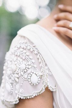 Scalloped sleeves.