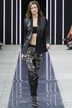 Maxime Simeons Black pants embellished with silver beads. Leather and cashmere jacket. #ss14