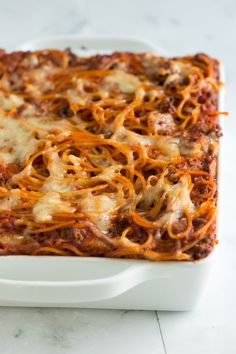 Baked Spaghetti- I made this last night and it was a big hit. I did modify it a little bit: 1. I added some Italian sausgae to the ground beef.  2. I added green pepper along with the onions.  3. When making the pesto sauce I added an 8oz package of cream cheese along with the sour cream and it tasted AMAZING!!   My husband has never liked baked spaghetti but he loved this!