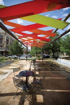 Colorful #fabric shade #structures designed by Rios Clementi Hale architects invite passers-by to enjoy San Antonio's Main Plaza in the heart of town.