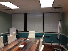 The Louver Shop Plantation Shutters Perfectview style in a conference room.Our perfectview option on Louverwood custom plantation shutters give a clean look to this conference room.  All the privacy and light control that is needed with a custom fit and stylish look.