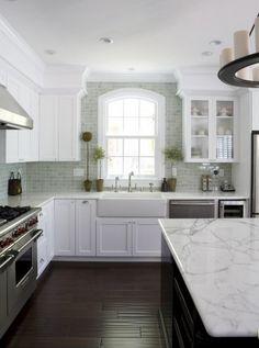 White granite, white cabinets, gray back splash, dark hardwood. LOVE