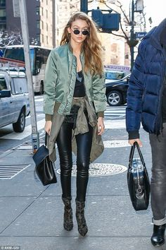 The 21-year-old model looked ready for action in a khaki bomber jacket as she stepped out for meetings in the city on Wednesday, with skinny leather leggings