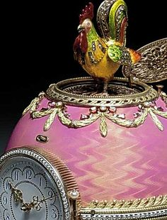 eggs__Rothschild Faberge Clock Egg 1902 Cockerel in the Cockerel Egg. The gold and enamel egg has been dated 1902 and signed by Karl Faberge. It features a clock with a diamond-set cockerel that pops up every hour and flaps its wings. Fabrege Eggs, Art Nouveau, Alexandra Feodorovna, Imperial Russia, Egg Art, Objet D'art, Egg Decorating, Krystal, Easter Eggs