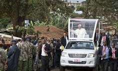 Pope Francis waves to local residents as he drives to St. Joseph The Worker Catholic Church in the Kangemi slum of Nairobi, Kenya Friday, Nov. 27, 2015. Pope Francis is in Kenya on his first-ever t...