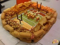 Ok, I am going to learn how to make this! Looks like 7 layer dip on the bottom made into a football field. Love this!