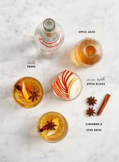 Apple Spice Cocktail - Apple Juice, Cinnamon Sticks, Anise, Vodka, Lemon Juice, Sparkling Water, Lemon Slices.