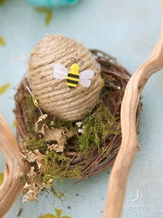 easy twine wrapped egg..stick on a bumble bee sticker and you've got a cute bee hive:):