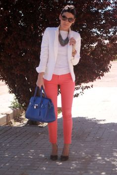 White with coral pants and blue bag.
