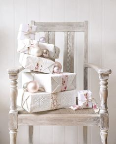 Christmas Gift Wrapping - wrap all your gifts with white wrapping paper & then use either white ribbons of varying textures & patterns or use a pop of color with the ribbon choice.