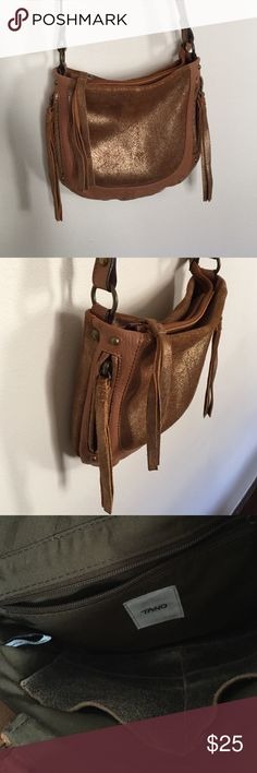Tano leather crossbody bag from Anthropologie Tan and metallic gold leather crossbody bag with two vertical tassle zip pockets on either side of front with and one large main zip compartment, also with leather tassle zips. Has one inner zip pocket and two slip pockets. Tano Bags Crossbody Bags