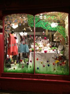 Spring has arrived at Marcos & Trump, Columbia Road, London. Alice in Wonderland window display by Amber Anderson.