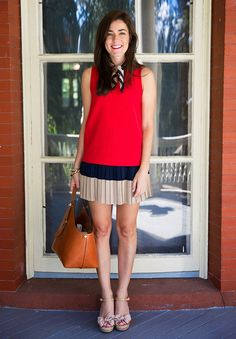 Scarf by Kate Spade, shirt by Diane Von Furstenberg, skirt by Club Monaco, bag and shoes by Tory Burch. (September 7, 2014)