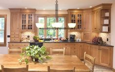 Oak Shaker kitchen cabinets I kinda like these....but I am just not feeling the wood cabinets.