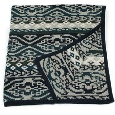 """the world traveler"" fairisle blanket in navy: traditional knits for the non-traditional baby. the perfect size for cribs, strollers, and cuddling. 100% made in the USA from recycled cotton"