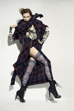 Vivienne Westwood is a beautiful artist in my eyes because she uses a lot of tartan, she's out there and crazy looking.