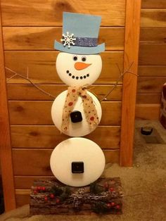 Snowman mad from pot and pans lids