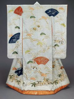 """""""Long-sleeved outer robe (uchikake) for a wedding with design of decorated fan papers, bamboo, plum, pine, tortoises and cranes in pink, orange, blue and green created by tie-dying, silk embroidery and gold metallic thread couching on a white silk damask ground; lined with reddish-orange silk and padded at the hem. Satin damask (rinzu); tie resist-dyed (kaneko shibori), embroidered in silk, couched with gold-wrapped thread"""" 19th century, Japan. MFA. (William Sturgis Bigelow Collection)"""