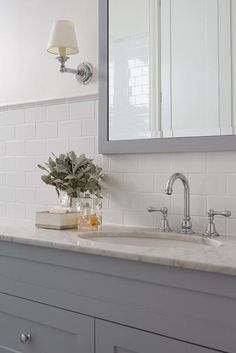 Great combination of my favorite things subway tiles, grey vanity and marble top!! Love that look