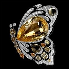 Rosamaria G Frangini | High Animal Jewellery | Cartier Butterfly Brooch, Solar Landscape – Bracelet-Brooch – white gold, yellow gold, one 42.77-carat pear-shaped yellow sapphire, yellow sapphires, colored diamonds, black lacquer, brilliants. Butterfly can be detached and worn as a brooch.