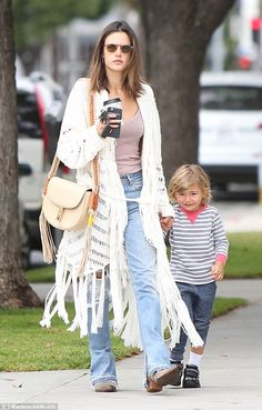 Boho style: Model Alessandra Ambrosio wore a fringed coat while out with three-year-old so...