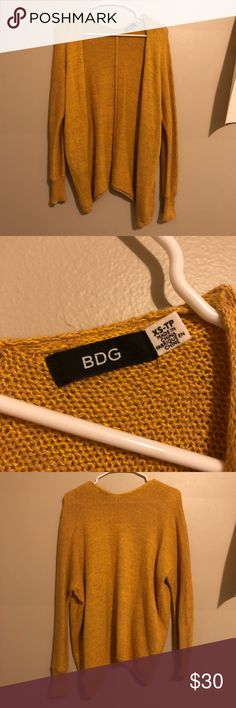 BDG URBAN OUTFITTERS CARDIGAN NWOT  bought over the summer then never wore  it looks more yellow in the pics but its a nice mustard yellow look (basic art hoe cardigan)  size XS fits xs/s Urban Outfitters Sweaters Cardigans
