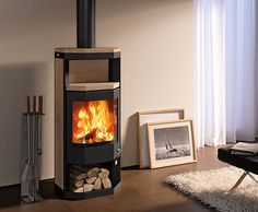 Contemporary wood-burning stove (steel) ADANO SKANTHERM