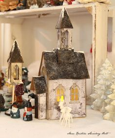 Church - Tim Holtz Village - note the people - sculpy clay? Christmas Village Houses, Putz Houses, Christmas Villages, Christmas Home, Bird Houses, Christmas Crafts, Christmas Decorations, Holiday Decor, Christmas Glitter