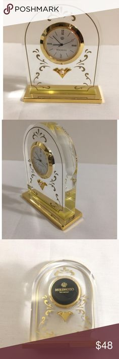 """Mikimoto GOLD Tone Pearl Shelf Quartz Clock Japan Auth Mikimoto International GOLD Tone Pearl Shelf Quartz Clock  Japan  Pre-woned but never was used    Please notice, on the button of the clock there is a company memorial stamp in Japanese writing.    3 6/8"""" Height  3 1/8"""" Wide  Battery was placed and currently it is working.  comes with all original cards and instruction and packaging Mokomoto Accessories"""