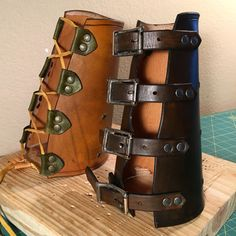 Leather arm guards / bracers for traditional #archery. Made to protect your bow arm when shooting arrows. One uses a rawhide cord to tighten, and the other uses four buckles. Both are lined with deer skin.