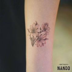 Three flowers on the left inner forearm.