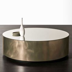 The Gong table by Meridiani is availalbe in many sizes, shapes and finish combinations, including this example of brushed platinum steel with a mirrored finished top. Modern Furniture Stores, Bongs, Indoor, Belt, Shapes, Contemporary, Steel, Table, Top