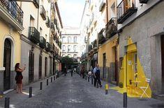 Light Installation Onto a Grey Street by Fos