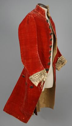 Formal coat, Europe, c. 1780. Red silk velvet, fancy buttons with green glass jewel, metallic tinsel and sequins, white silk cuff decorated with metallic embroidery.