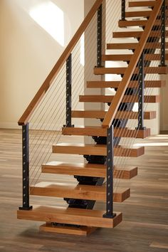 We offer one of the widest selections of modern railing systems in the Southeast. Let our team design an amazing modern railing system for your staircase Modern Staircase Railing, Stair Railing Design, Home Stairs Design, Metal Stairs, Floating Staircase, Modern Stairs, House Design, Staircase Diy, Staircase Architecture