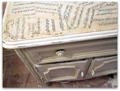Decoupage sheet music to a table top and add a scrolling vine to the corners.