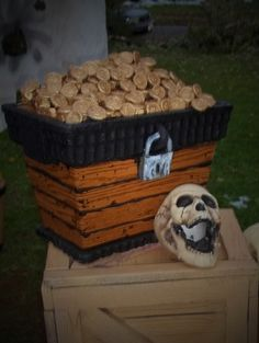 Styrofoam Cooler to look like pirate chest on Halloween forum. Halloween or Pirate party would be great