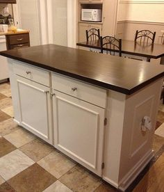 This island is my absolute favorite!!!  I would alter the plans to scale a bit smaller to fit in the breakfast nook, and somehow have a drop leaf to use with barstools.    Kitchen Island with Farmhouse Table Top | Do It Yourself Home Projects from Ana White