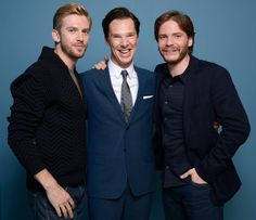 (L-R) Actors Dan Stevens, Benedict Cumberbatch and Daniel Bruhl of 'The Fifth Estate' pose at the Guess Portrait Studio during 2013 Toronto International Film Festival on September 6, 2013 in Toronto, Canada.