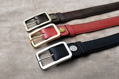 Dominique Saint Paul. Hand coloured crust leather belts 3cm with custom made Dominique Saint Paul buckles in antique brass, palladium and gold.