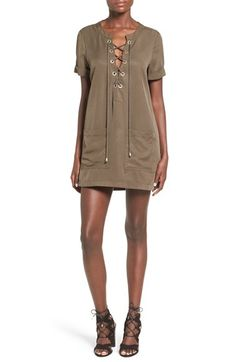 Free shipping and returns on Lovers + Friends 'Waterfront' Shift Dress at Nordstrom.com. Corded ties lace through the metallic grommets of a lightweight and laid-back chambray shift dress. The summery look features rolled sleeves and oversized front patch pockets.