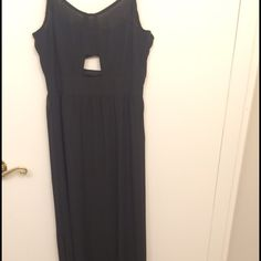Beautiful black summer dress H&M long black dress. Cutout in the front middle. Lace up back. Sheer dress with a black slip underneath. Never been worn bought too small. H&M Dresses Maxi
