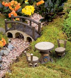 """Miniature Fairy Garden Tree Stump Furniture Set: Sure to attract garden fairies to your yard, our Fairy Garden Tree Stump Furniture Set is a fun and whimsical addition to your magical miniature garden. Crafted of durable, weather-proof resin, the Fairy Garden Tree Stump Furniture Set includes a tiny table with """"Home"""" sign, two chairs and a charming arched footbridge, all looking as though they were made by the garden fairies themselves out of handy tree stumps and branches. #fairygarden"""